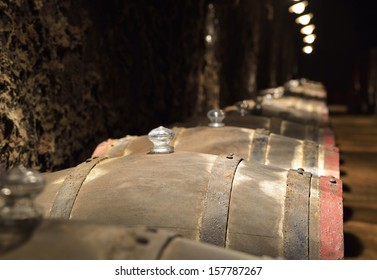 Barrels of wine in an old wine cellar