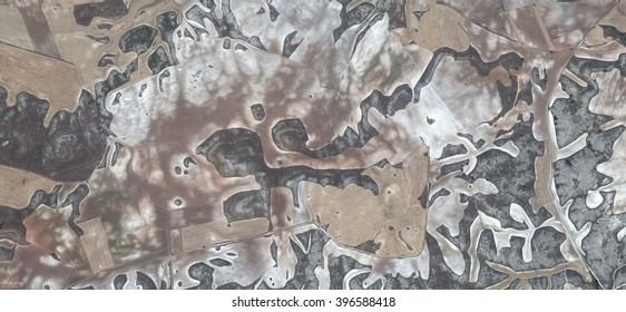 barren fields,allegory, tribute to Picasso, abstract photography of the Spain fields from the air, aerial view, representation of human labor camps, abstract, cubism, abstract naturalism,