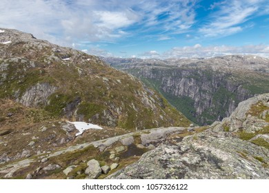 Barren granite rock landscape along world famous Kjerag mountain, a popular hike among tourists in Rogaland, Norway