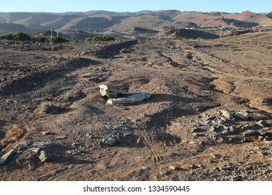 Barren volcanic land in south of Gran Canaria with dark sand,stones and pebbles.