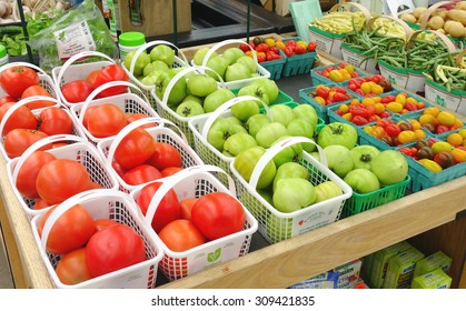 BARRIE, CANADA - AUGUST 8, 2015: Tomatoes selection at a farmers market in Barrie, Canada.
