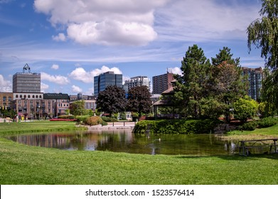 Barrie, Ontario, Canada - 2019 08 25: Summer view on the pond in the Heritage Park in Downtown Barrie, Ontario, Canada.