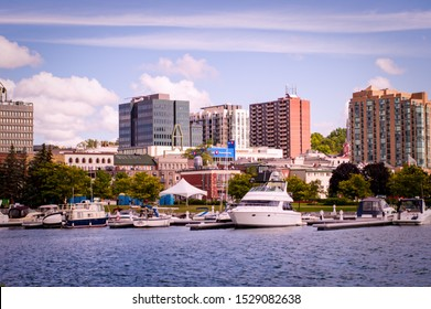 Barrie, Ontario, Canada - 2019 08 25: Lake Simcoe shore view with the Heritage Park on the right the city of Barrie, Ontario, Canada.