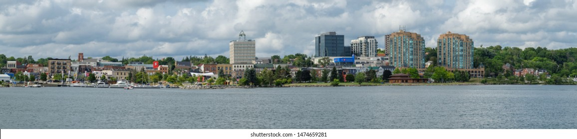 Barrie, Ontario, Canada - Aug 6, 2019: City of Barrie waterfront panorama with marina, condo buildings, banks, parks and infrastructure.