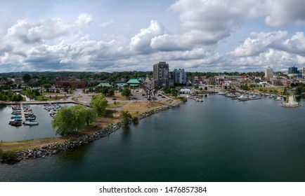 Barrie, Ontario, Canada - Aug 6, 2019: City of Barrie waterfront aerial drone panorama with Lake Simcoe marina, condo buildings, banks, parks and infrastructure.