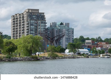 Barrie, Ontario, Canada - Aug 6, 2019: City of Barrie waterfront panorama with Lake Simcoe marina, condo buildings, banks, parks and infrastructure.