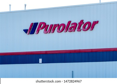 Barrie, Ontario, Canada - August 4, 2019: Sign of Purolator Shipping Centre in Barrie, Ontario, Canada.Purolator is Canada's leading integrated freight and parcel solutio.