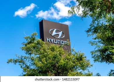 Barrie, Ontario, Canada - August 4, 2019: Sign and logo of Hyundai at dealership in Barrie, Ontario, Canada. Hyundai Motors is a South Korean multinational automotive manufacturer.