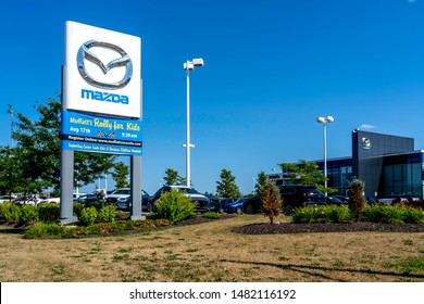 Barrie, Ontario, Canada - August 4, 2019: Sign of Mazda at dealership in Barrie,  Ontario, Canada.  Mazda Motor Corporation is a Japanese multinational automaker.