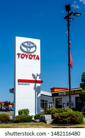 Barrie, Ontario, Canada - August 4, 2019: Sign of Toyota at dealership in Barrie, Ontario, Canada.  Toyota Motor Corporation is a Japanese multinational automotive manufacturer.