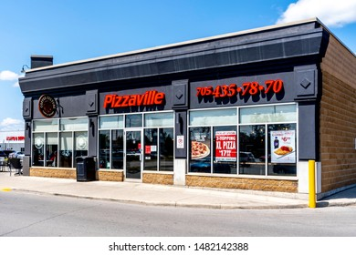 Barrie, Ontario, Canada - August 4, 2019: A Pizzaville restaurant in Barrie, Ontario, Canada. Pizzaville is a Canadian pizza chain.
