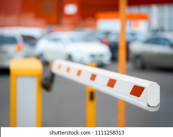 barrier close-up against the background of car parking