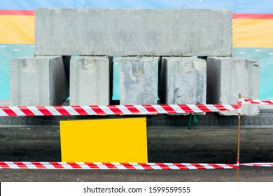 barrier fencing white and red warning tape of the danger zone of the test of block panels under load for deflection.