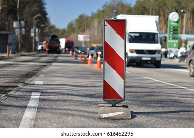 barrier repairs road and workers