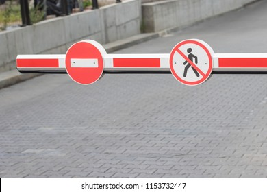 barrier with road signs. Do not enter.