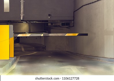 Barrier in an underground parking. At the Basement Parking, carpark with signboard and details