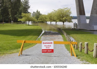 A barrier warns of a flooded area ahead/Flooded area Warning/Sign warns of flooding ahead