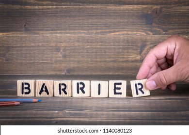 Barrier. Wooden letters on the office desk, informative and communication background