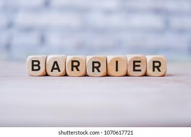 BARRIER word written on wood block