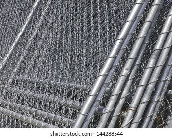 Barriers in abundance: Stack of chain-link fencing on construction site