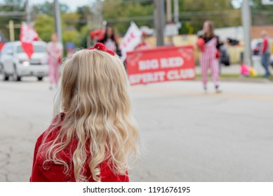 Barrington, IL/USA - 09-29-2018: Little girl watching the spirit squad march in hometown homecoming parade