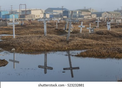BARROW, ALASKA- JUNE 3, 2012: Cemetery slowing sinking into permafrost.
