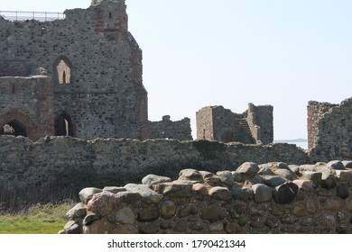Barrow in Furness, Cumbria / England - April 19, 2019: Part of the ruin of the old castle in the centre of Piel Island. Lots of fallen and weathered walls but still some parts standing. Bright day.