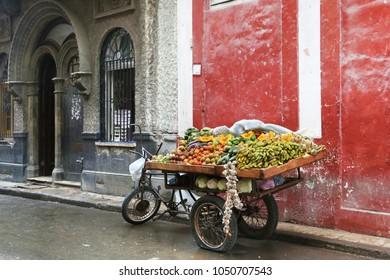 Barrow of a street greengrocer in Havana, Cuba. No people.