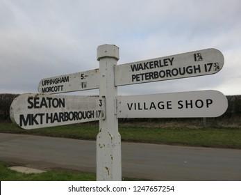 Barrowden, Rutland. England. February 16, 2012. Village shop sign post. The Jurassic Way.