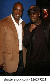 """Barry Bonds and Arsenio Hall at the premiere of """"Dreamgirls"""". Wilshire Theatre, Los Angeles, California, December 11, 2006."""