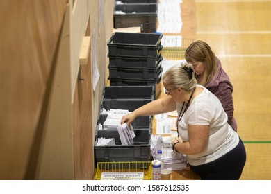 Barry, Wales, UK. December 13th 2019. Voting slips are organised during the general election vote count for the Vale of Glamorgan at Barry Leisure Centre.