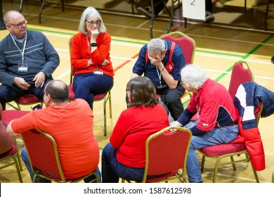 Barry, Wales, UK. December 13th 2019. Dejected Labour party supporters after the Vale of Glamorgan general election vote count at Barry Leisure Centre.