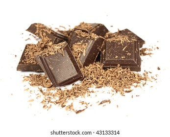 Bars of chocolate with milled chocolate on white background
