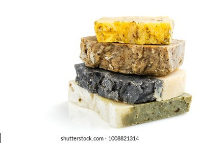 Bars of natural organic soap with dried herbs isolated on white background. Handmade soap making. Spa products and skin care concept