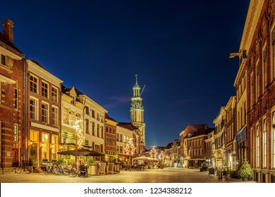 Bars and restaurants with christmas lights on the Houtmarkt square in Zutphen, The Netherlands
