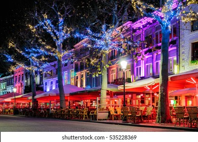 Bars and restaurants with christmas lights on the famous Vrijthof square in Maastricht, The Netherlands