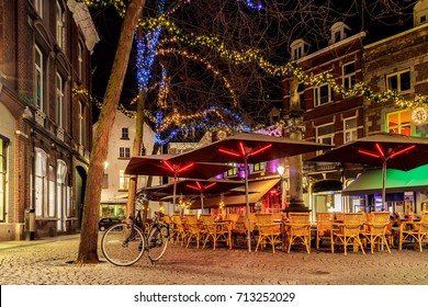 Bars and restaurants with christmas lights on the Sint Amorsplein square in Maastricht, The Netherlands