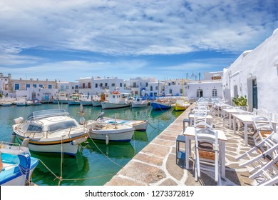 Bars and restaurants at the traditional Greek fishing village of Naousa, Paros island Greece, during summer time