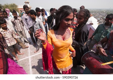 BARSANA, INDIA 21 MARCH 2013 :Unidentified transgender or hijra dancing and celebrating the traditional, ritualistic Holi at Radha Rani temple.
