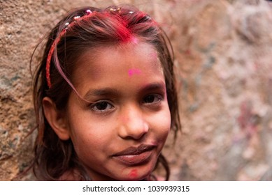 Barsana, India - February 25, 2018: A young girl after playing with colours on the day of Holi