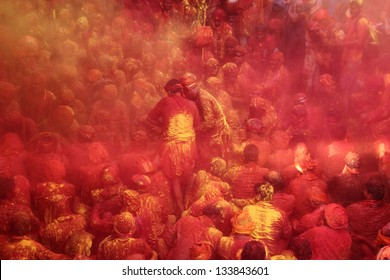 BARSANA - MAR 21: Devotees celebrate a traditional and a ritualistic Holi at Radharani temple on March 21, 2013 in Barsana, India. Holi is the most celebrated festival in India.