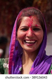 BARSANA - MARCH 20 : Unidentified woman with face smeared with colors participate in the colorful Holi celebration at Krishna temple on March 20, 2013 in Barsana, Uttar Pradesh, India.