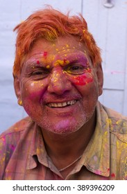 BARSANA - MARCH 21 : Unidentified woman with face smeared with colors participate in the colorful Holi celebration at Radharani temple  on March 21, 2013 in Barsana, Uttar Pradesh, India.