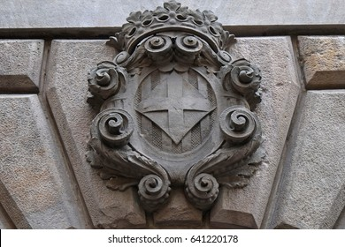 BARSELONA, CATALONIA - SEPTEMBER 15, 2016; Coat of arms above the entrance to the building in historic center of Barselona, Catalonia