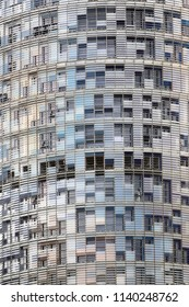 Barselona, Spain - 06.10.2017: The background of a Skyscraper of glass and steel with thousands of mirrored Windows.