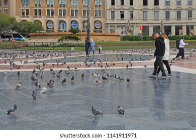 BARSELONA, SPAIN - MAY 10, 2017: This is a paved platform in the central part of Catalonia Square on which there are always plenty of pigeons.