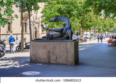 BARSELONA, SPAIN - MAY 12, 2017: Sculpture Resting Giraffe is a figure of a giraffe lying in a resting flirtatious pose on the boulevard in the center of the city.
