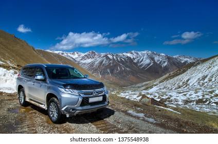 Barskoon pass / Kyrgyzstan 05/07/2018: New Mitsubishi Pajero Sport pass the Barskoon mountains