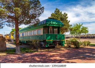 Barstow, CA / USA – April 14, 2019: Green vintage railroad passenger car at the Western America Railroad Museum located at the Barstow Harvey House at 685 North 1st Avenue in Barstow, California.