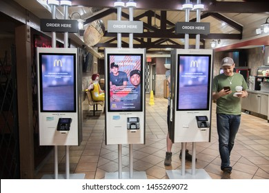 Barstow, California:  July 15, 2019:   A McDonald's self-service kiosk in a Barstow McDonald's.   McDonald's has been investing in self-service kiosks in the last several years.